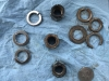 The old nuts and lock nuts......the shipwright used the old ones with no protection......all 3 lock nuts were broken and the nyloc nut in bad shape...the shiny lock nuts are the new ones!!